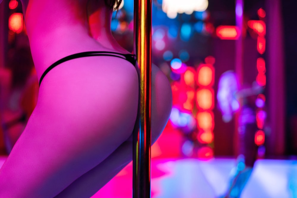 Girl doing pole dance in strip club