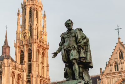 Rubens statue with Antwerp`s Cathedral of Our Lady (Dutch: Onze-Lieve-Vrouwekathedraal) at the backdrop