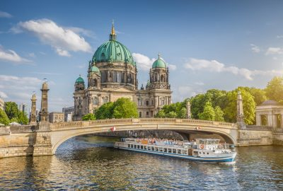 Berliner Dom and boat passing under the bridge in Berlin