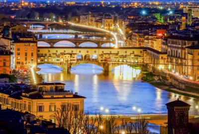 Panoramic view of the bridge Ponte Vecchio in Florence with night illumination