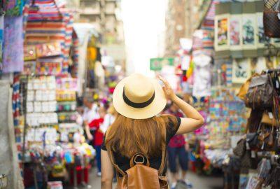 Tourist shopping at market in Mong Kok district of Hong Kong