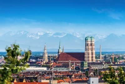 Frauenkirche cathedral with at the backdrop the mountains around Munich