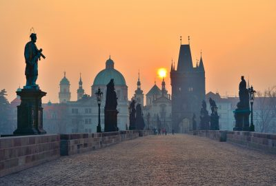 Charles Bridge and its Baroque statues in Prague at sunset
