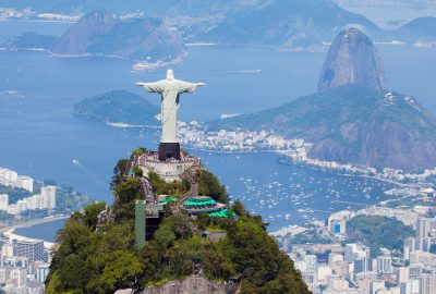 The statue of Christ the Redeemer standing on the top of Corcovado mountain in Rio de Janeiro