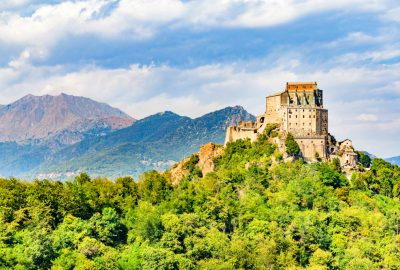 Sacra di San Michele on top of a green mountain near Turin