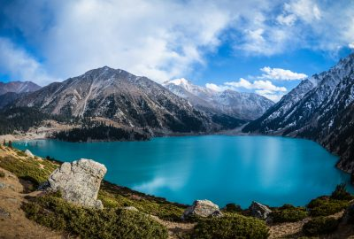 Big Almaty Lake surrounded by mountains