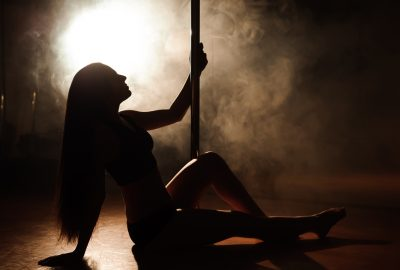 Silhouette of girl pole dancing in Antwerp striptease club