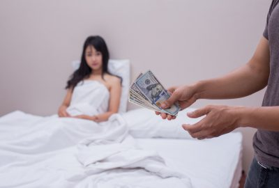 Chinese prostitute in Beijing brothel paid by client