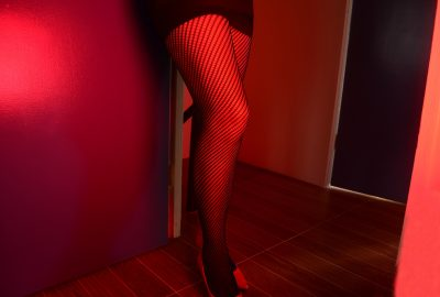 Brussels prostitute in red light district waiting for clients in