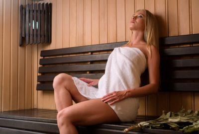 Blonde lady chilling in sauna of Copenhagen FKK club