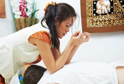 Lady providing a Thai massage in Asian studio in Copenhagen