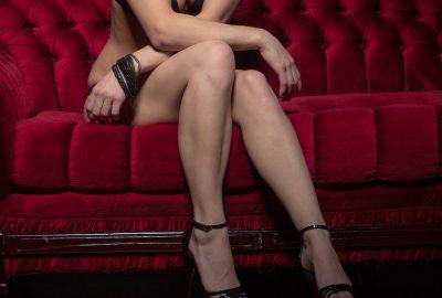 Dublin bordello girl on red sofa