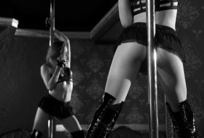Pole dancer reflected in mirror of Dublin striptease club