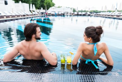 Couple enjoying outdoor swimming pool of Dusseldorf FKK club