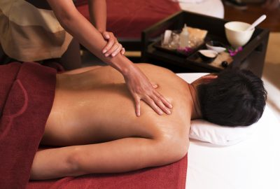 Man receiving back massage in Asian massage salon in Florence