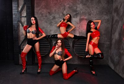 Four dancers of Florence striptease club dressed in sexy red latex