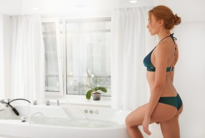 Sexy masseuse near whirlpool bath at Hamburg erotic massage studio