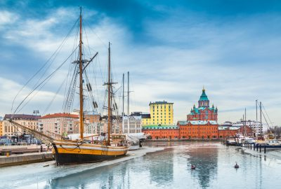 An old ship in Katajanokka harbour, Helsinki and the Russian Orthodox Cathedral in the distance