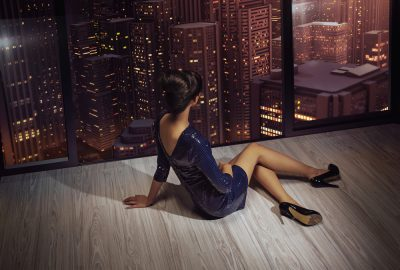 High class escort enjoying view of Hong Kong by night