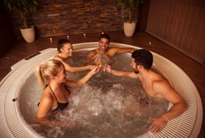 Two couples enjoying the Jacuzzi in a Nice swinger club