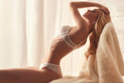 Blonde Riga escort in white lingerie