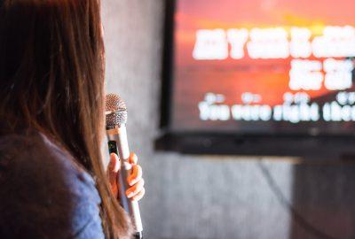 Japanese lady singing karaoke in KTV bar in downtown Tokyo