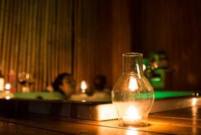 Asian masseuse relaxing in bath of Toronto erotic massage salon