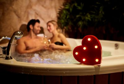 Couple in bathtub of erotic massage salon in Vienna