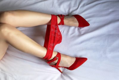 Vilnius escort in red panties and pumps on bed