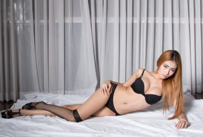 Asian escort with red hair in Abu Dhabi