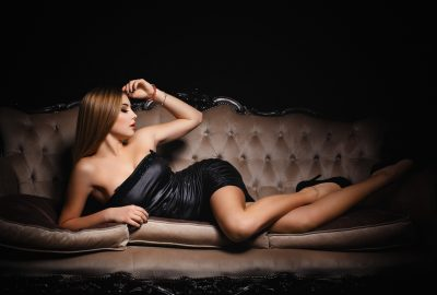 Girl laying on canape sofa in Auckland brothel