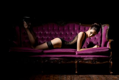 Barcelona brothel girl on canape sofa