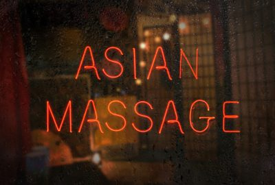 Window of Asian massage parlor in Bern