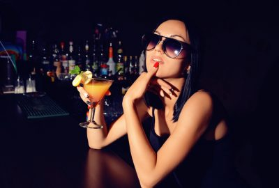 Freelance escort enjoying a cocktail at bar in Ibiza club