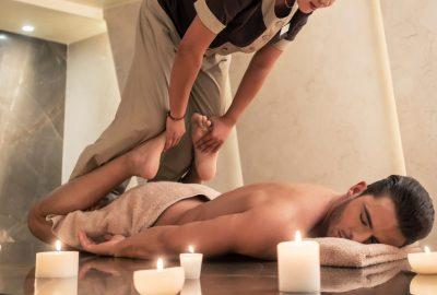 Man getting an intense massage in Thai massage salon in Liverpool