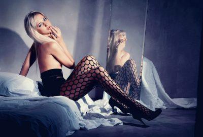 Blonde Slavic escort in Manchester sitting in front of mirror