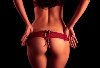 Stripper taking off her panties in Marbella striptease club