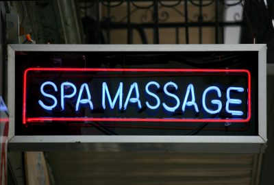 Neon light advertising spa massage in Moscow