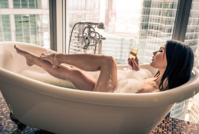 High class escort from Moscow drinking champagne while taking a bath