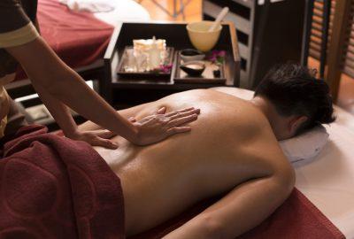 Customer receiving back massage in Thai massage salon in Oslo
