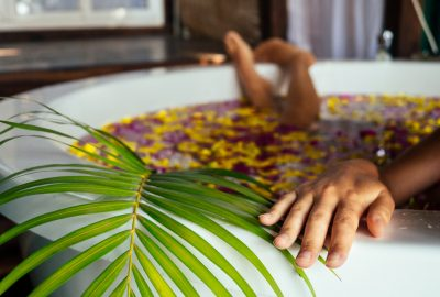 Girl in bath with rose petals in Singapore erotic massage salon