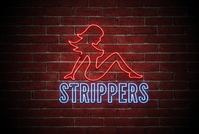 Sign for striptease club in Singapore