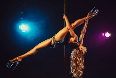 Blonde pole dancer demonstrates her flexibility in Warsaw striptease club
