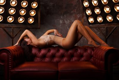 Girl posing on sofa of sex club in Zurich