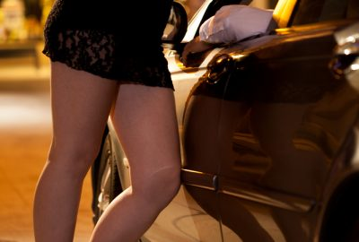 Zurich street prostitute talking to client in car