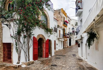 Cobbled street with charming traditional Spanish houses in Ibiza's Old Town (Vila d'Eivissa)