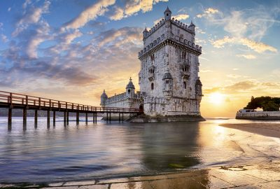 Belém Tower ((Torre de Belém) at the Tagus River against the sunset sky in Lisbon
