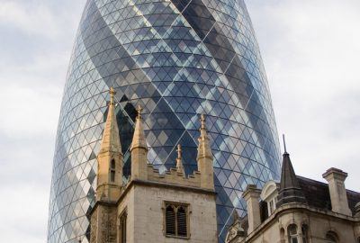 30 St Mary Axe aka The Gherkin in the City of London City with historical buildings at the forefront