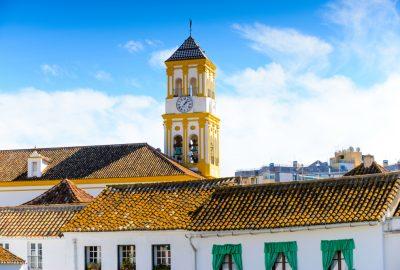 Yellow and white tower of the Iglesia Mayor de Santa María de la Encarnación in Marbella