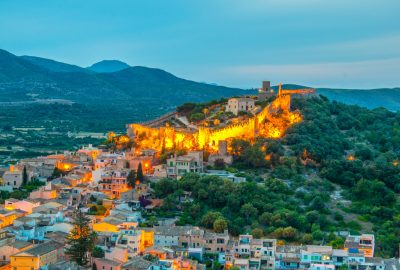 The walled fortress Castell de Capdepera illuminated at evening on the island of Majorca